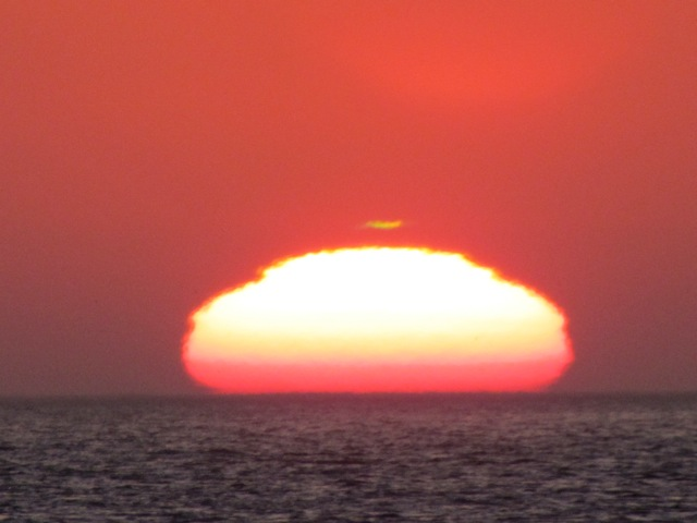 Green flash at sunset, by David